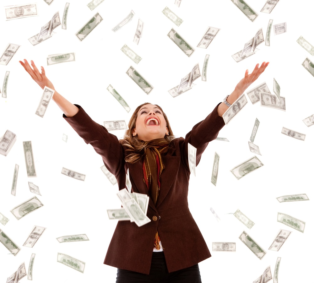 Business woman under a money rain - isolated over a white background.jpeg